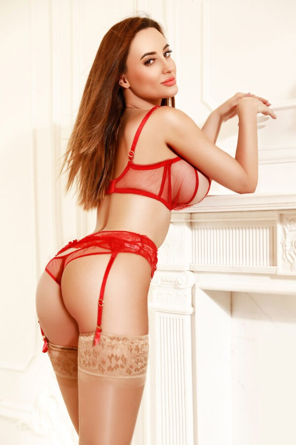 Top London escort Asia in her red lingerie and stockings