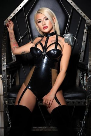 Fetish escort Ivy in an erotic black leather outfit