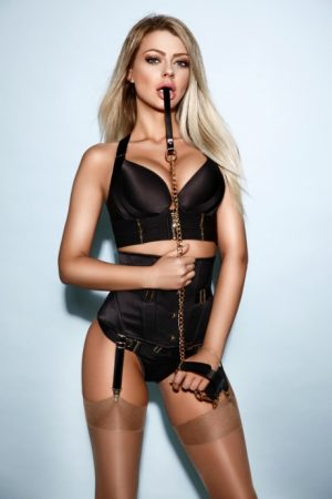 Sexy blonde escort Reece in her naughty BDSM outfit.