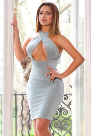 Stunning escort Deirdre in a sexy blue dress