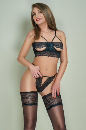 Mature London escort Ginger in stockings and lingerie