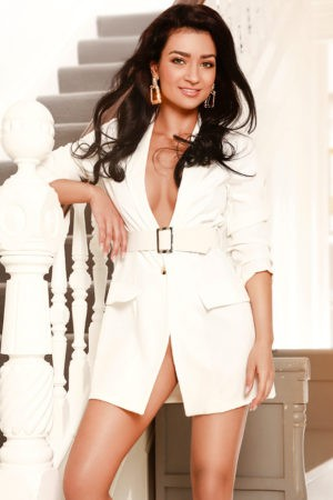 Bayswater escort Adelyn in white suit dress