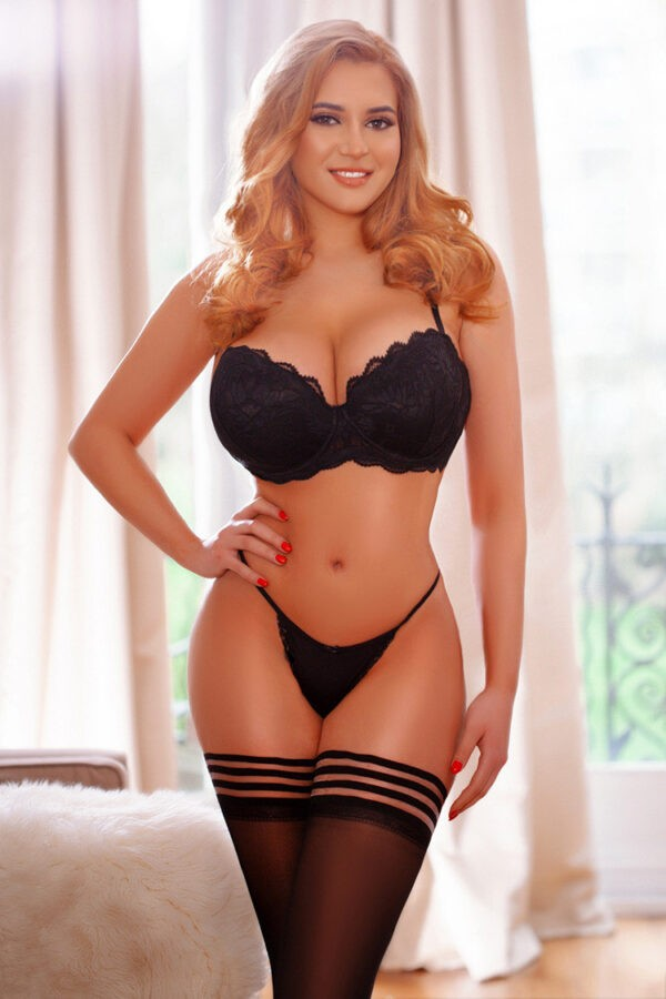 Agency recommended escort Avelina in her sexy black lingerie and stockings