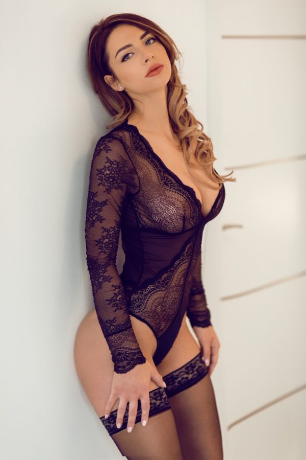Top escort Clover in black lace lingerie