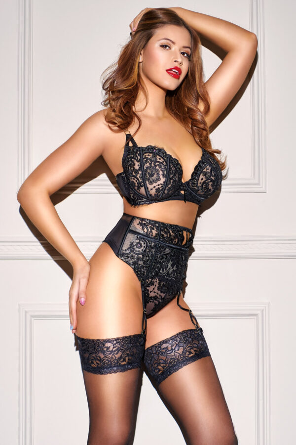 Sexy Brazilian escort Kim in her designer black lingerie and stockings.